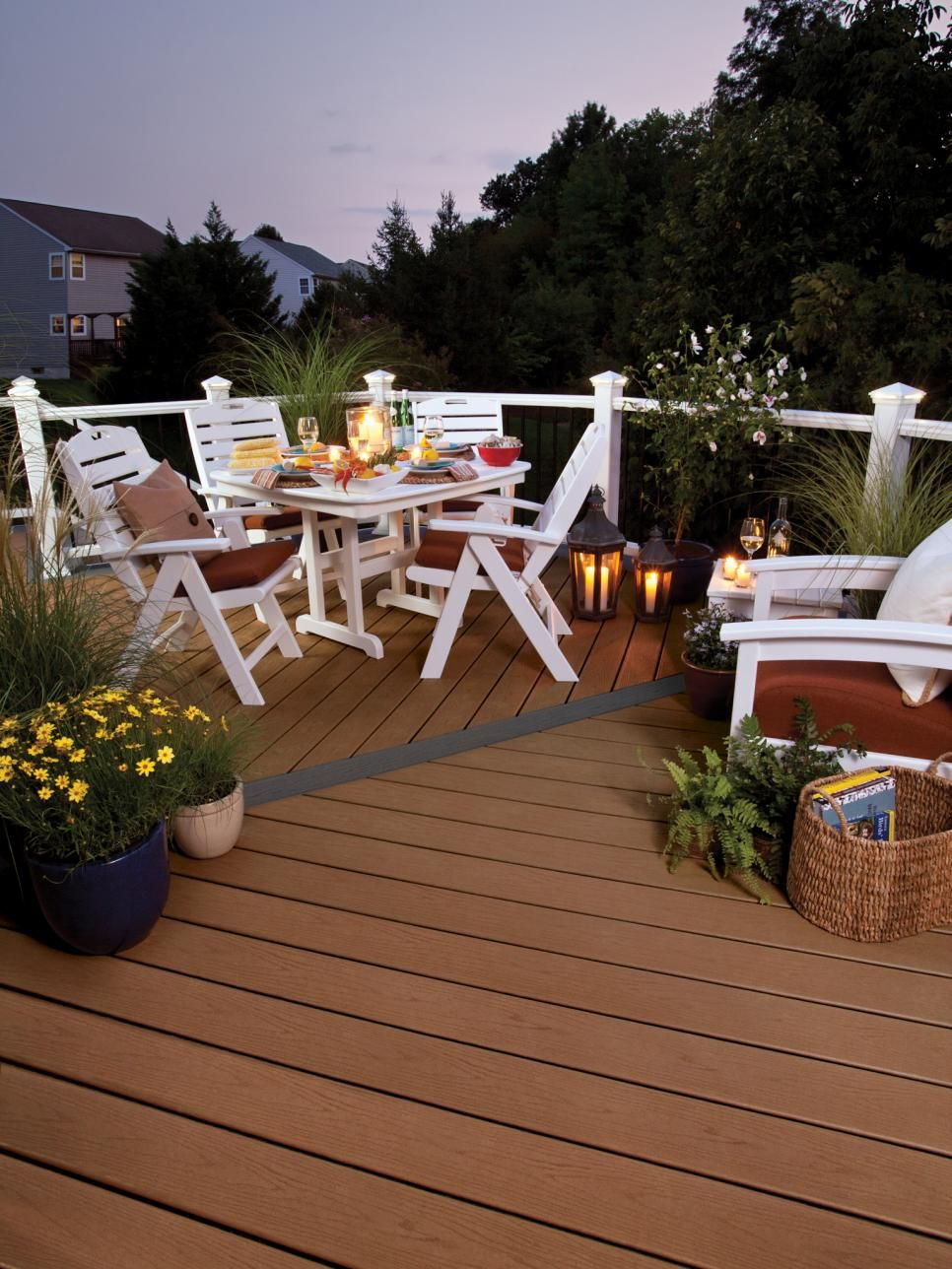 A Small White Wood Table And Chairs Create An Intimate Dining Area On This Wood Deck White Furnishings Paired With Green Plants So In 2020 Building A Deck Diy Deck Deck Cost