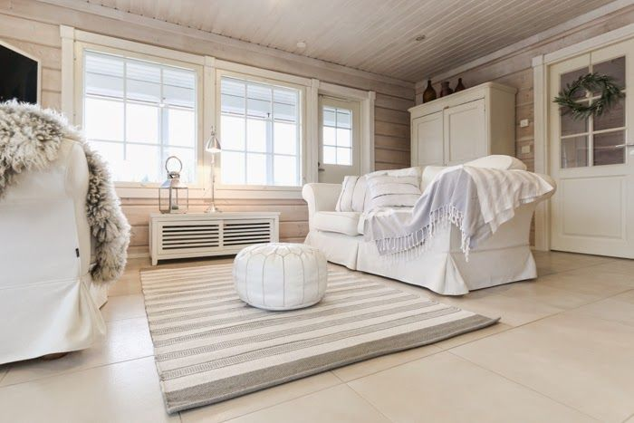 hirsitalo olohuone, livingroom, log home, scandinavian interior, nordic house, log house, modern log house