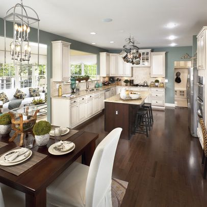 Smokey Blue Walls With Off White Cabinets And Dark Wood Flooring