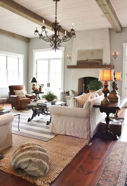 Beautiful light and airy living space persian rug stucco covered fireplace open beams also