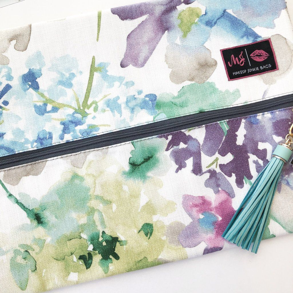 Obsessed with this watercolor floral Makeup Junkie Bag