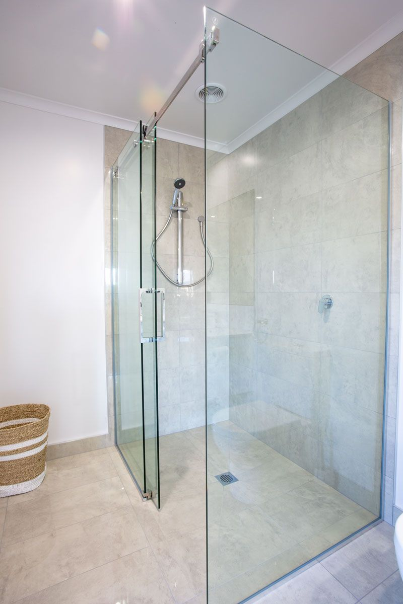 A Sliding Glass Shower Door Is A Clean And Modern Look Shower