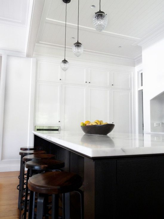 White cupboards with dark oak island, marble top. | The \'one day ...