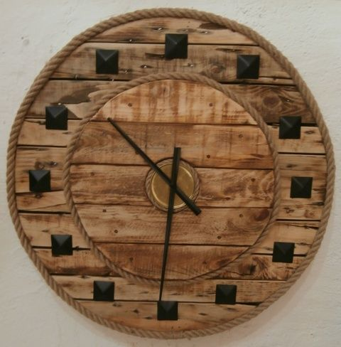 A solid, chunky clock made from the base of an old wooden cable reel ...