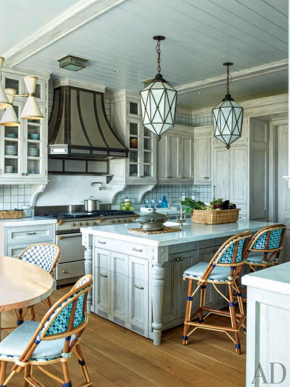 Ornamental range hoods give these stylish kitchens unique flair ...