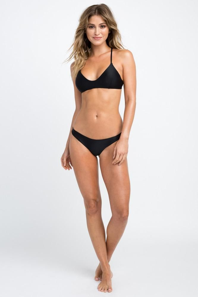 b4bb128d760 The RVCA Solid Cross Back Top is a sporty bralette-style swim bikini top  with a v-cut neckline and a crossed self-tie closure at the back.