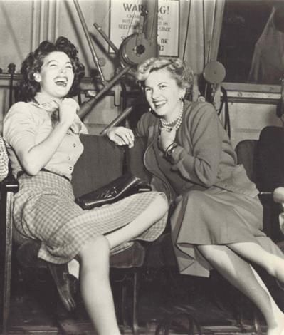 Ava Gardner and Joan Fontaine     love the layed back gals having a good laugh....great icons here....
