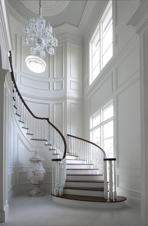Look at the small round window above stairs.. Love all the light from outside.