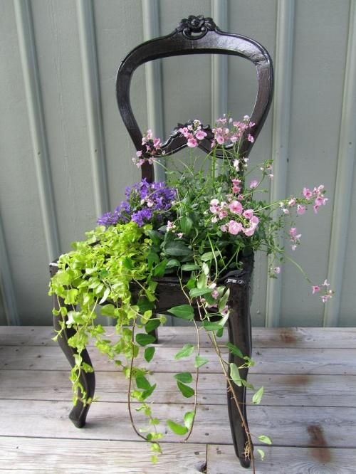 Reuse an old chair and make container for beautiful flowers.  Absolutely wonderful and so inspiring!