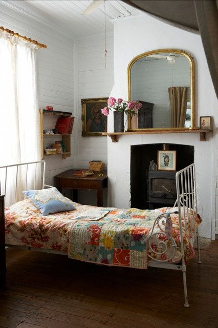 Fireplace, quilt, white iron bed, golden mirror, parquet... There's so much I like about this room.