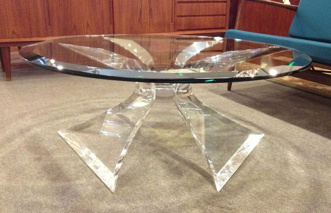 A dramatic round coffee table by lion in frost of florida