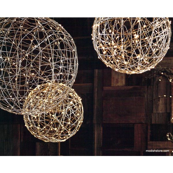 The Roost Silverlight Spheres - Fantastical spheres are woven from shiny nickel-plated wire and wrapped with strands of silver wire LED lights. Group the three sizes of spheres over a dining t