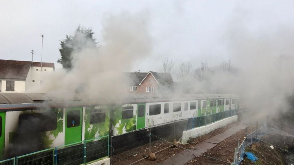 Ten evacuated as Kenilworth train catches fire - BBC News