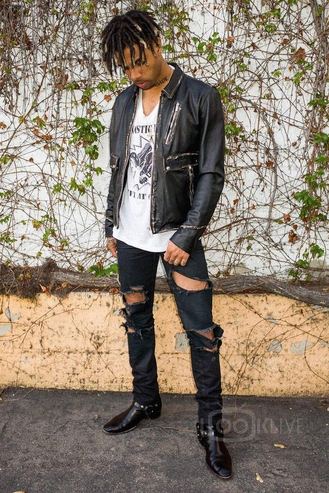 c4a2afb6a91 Vic Mensa wearing Saint Laurent Western Ankle Boots, Saint Laurent Ripped  Jeans, The Kooples Vintage Effect Leather Jacket