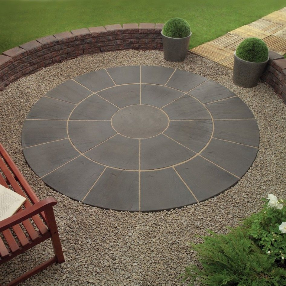 For the seating area by the sandstone wall, you could have a round, radial  pattern of sandstone pavers or you could have a compressed pavement look,  ... - Wonderful Grey Color Wood Stone Unique Design Backyard Patio Paver