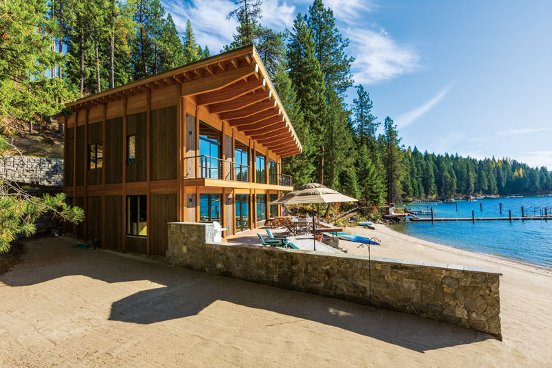 """A dramatic exterior sets thishome apart from others on the lake. """"Many of the homes at Priest Lake are more traditional with log home character, but we preferred something lighter and brighter with an open plan and large windows that highlighted the lake. We wanted a clean, uncluttered style that wouldn't distract from the views,"""" says Curt. #lakehouse #modern #home #design"""