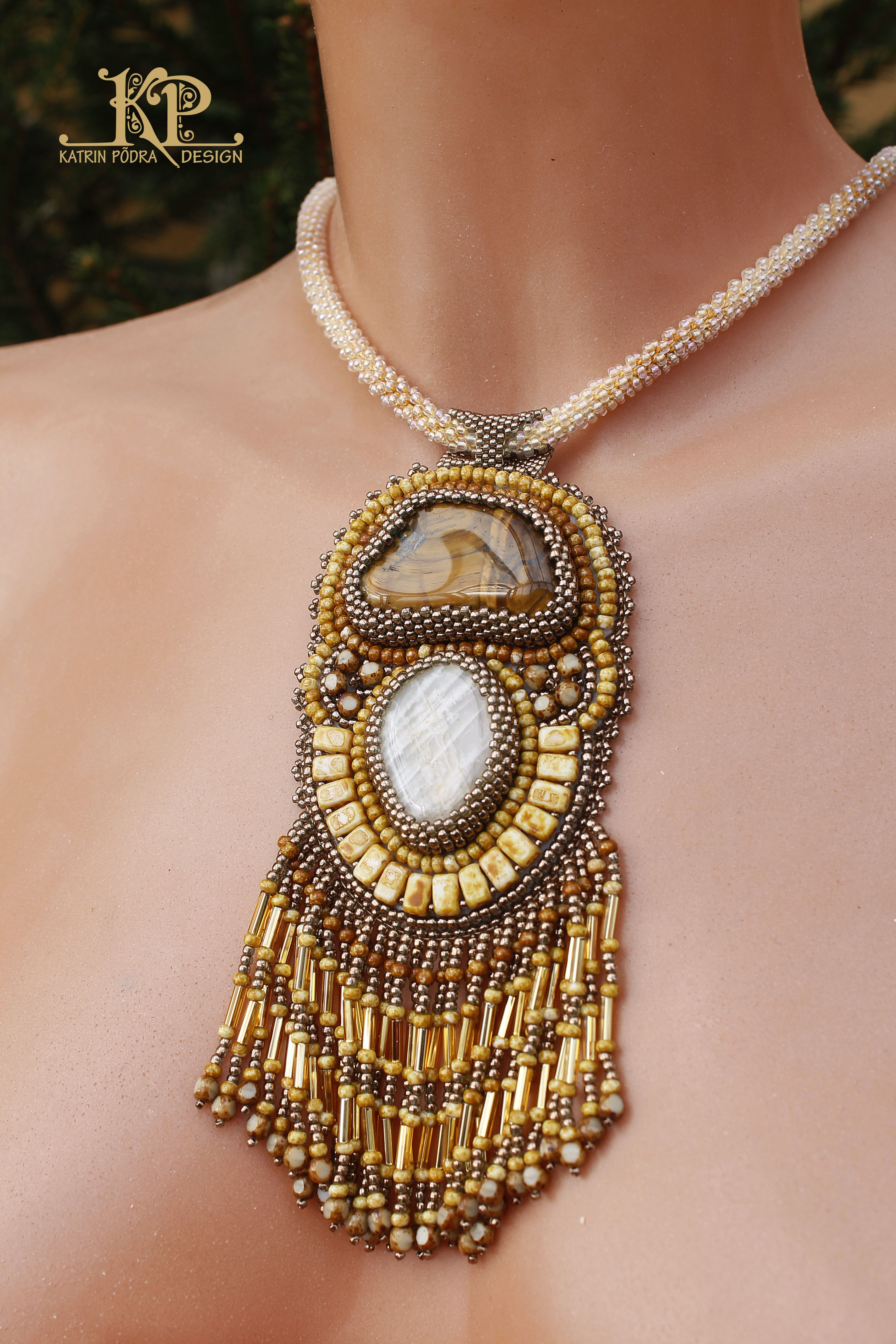 Bed embroidery necklace with moonstone and tiger's eye natural stone. Made by Katin Põdra.
