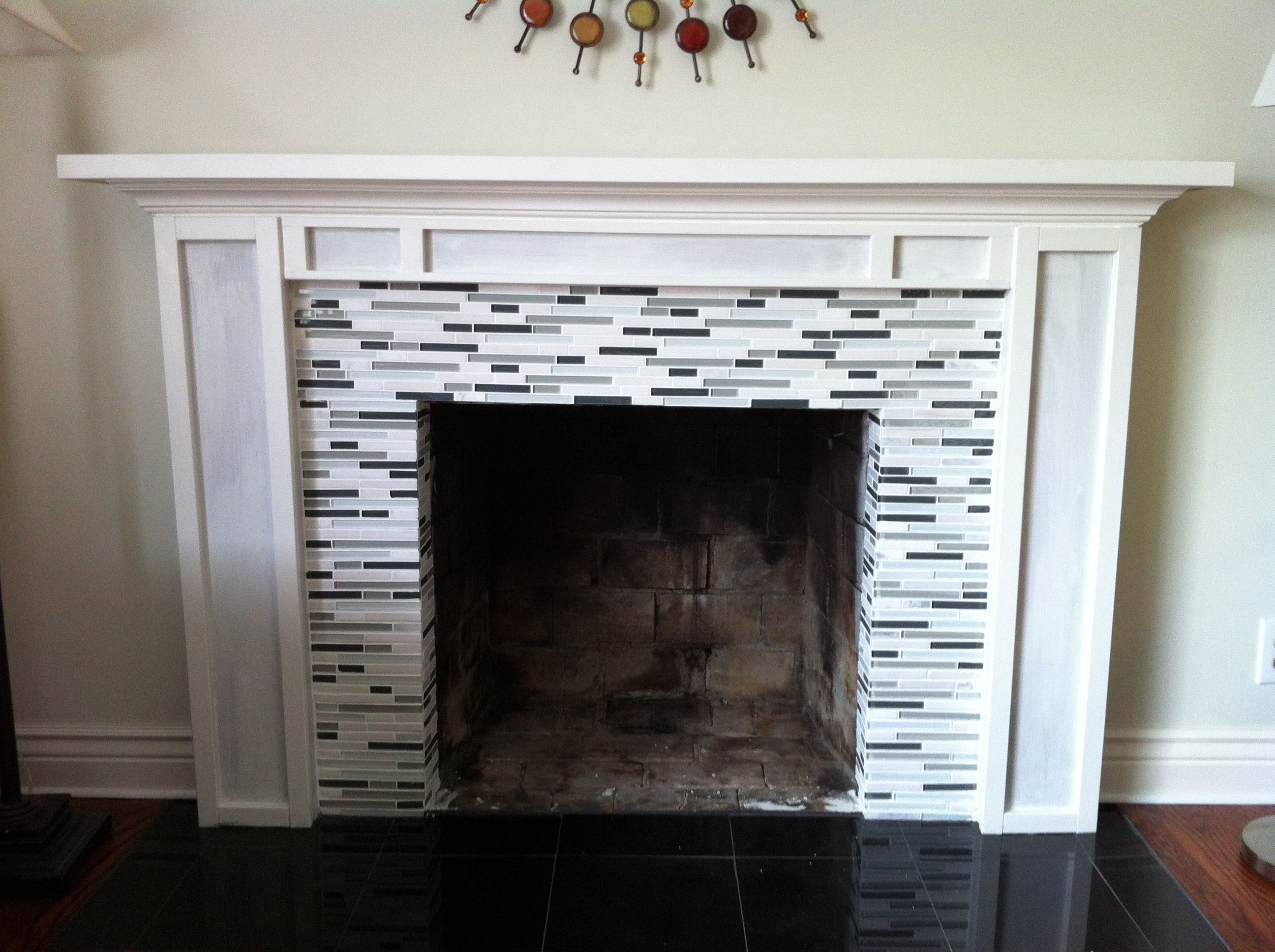 diy mantel with glass tile fireplace