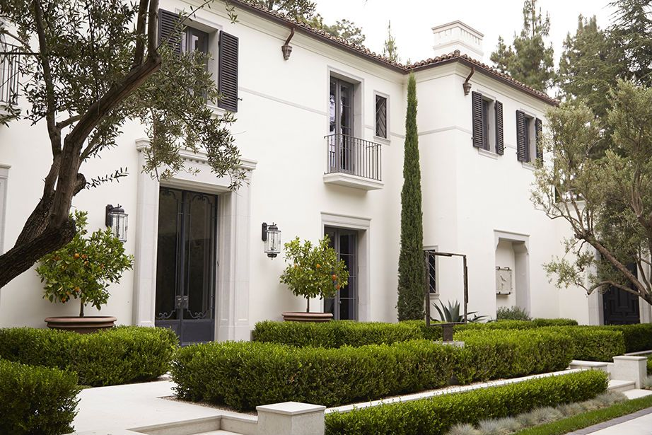 White Stucco Clay Tile Roof Modern Mediterranean Boxwood Hedges Clean White Exterior Black