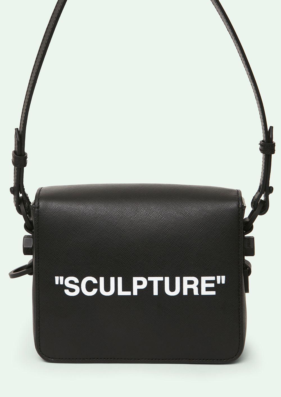 b3d835abfc99 Cross body leather binder clip bag in black with black industrial belt  strap.