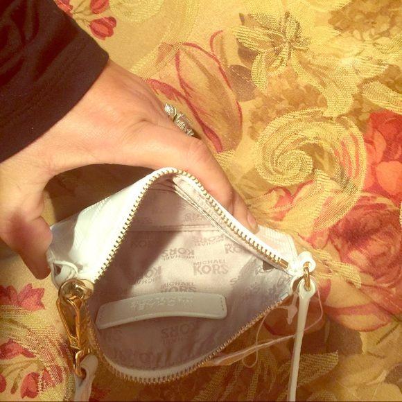 Authentic Michael Kors wristlet white color Authentic new w tags MK wristlet Michael Kors Bags Clutches & Wristlets