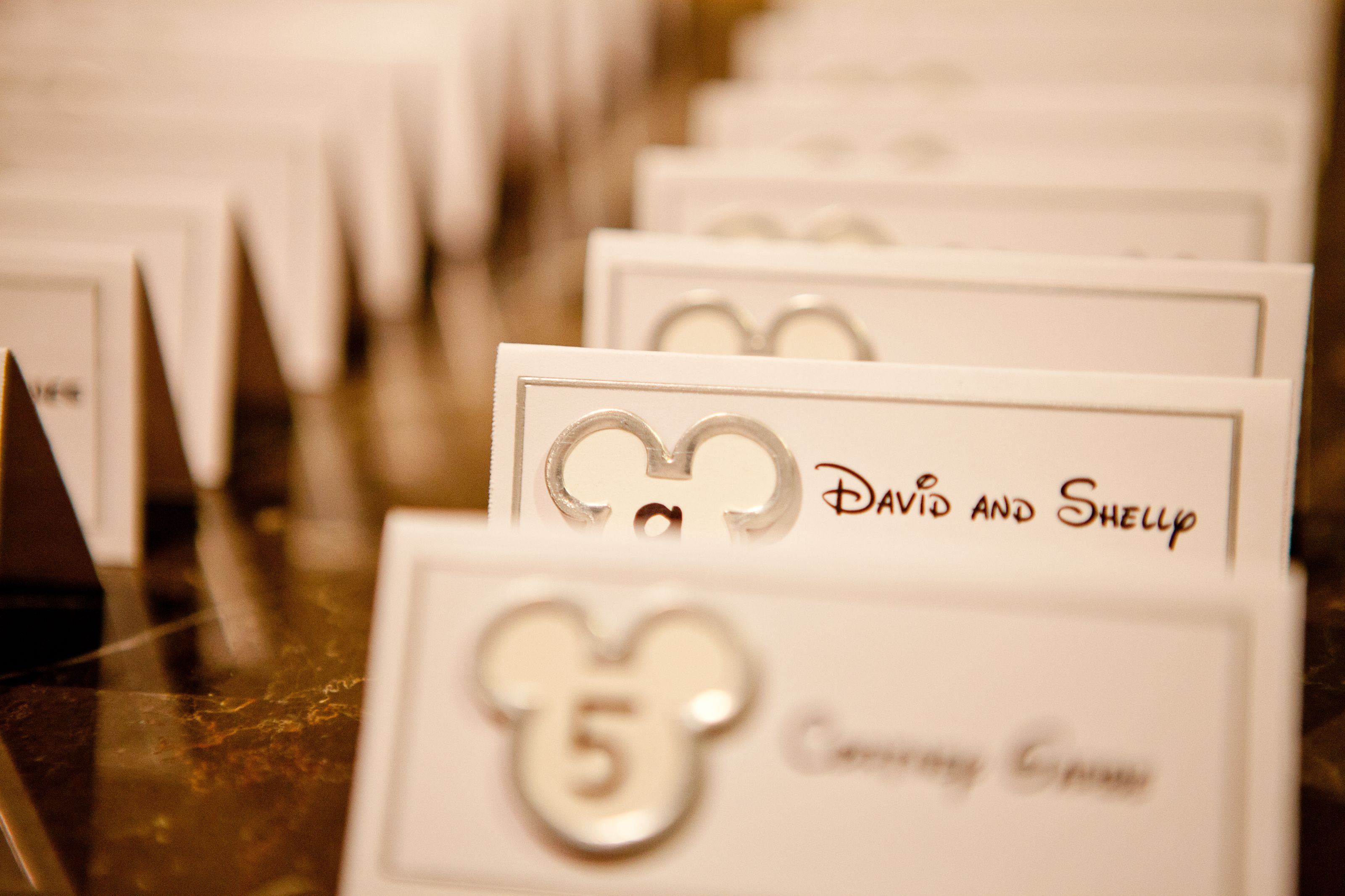 We made our own place cards with scrapbooking stickers and Disney