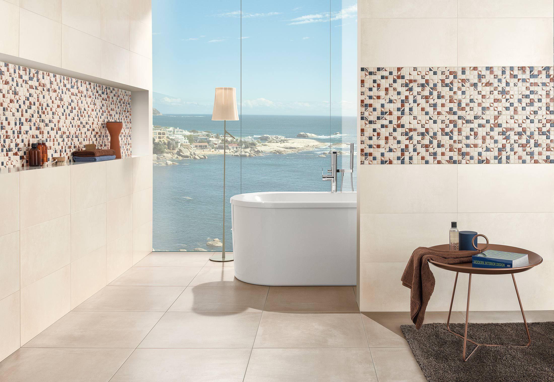 Een geheel betegelde badkamer met uitzicht d.m.v. een afbeelding in glas en verlichting achter de panelen.