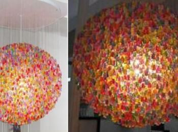 An attractive chandelier made of used beer bottles shiny gummy bear chandelier disgusting yet cant pull my eyes away aloadofball Images