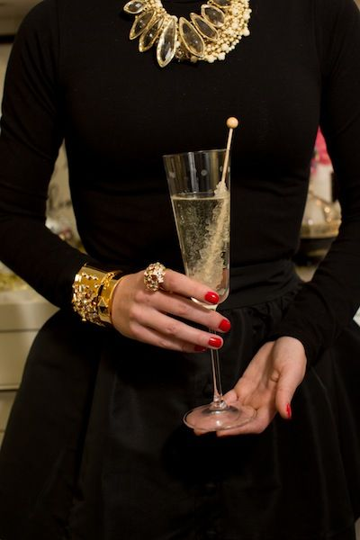 The perfect outfit in my book. Shiny baubles pop against the black and the red nails are the perfect pop of color!