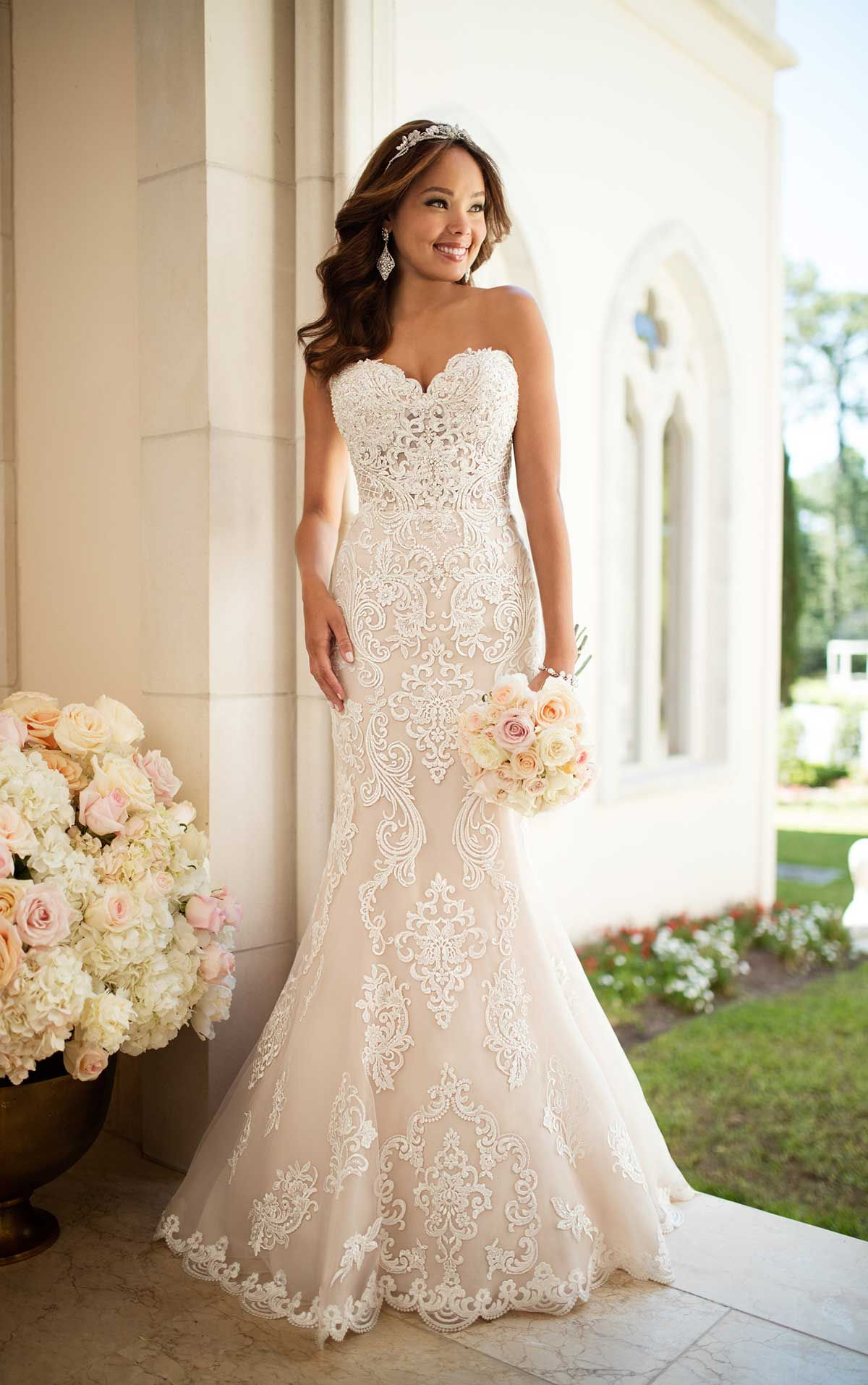 ef401424f6d65 Classic brides will love how elegant and refined they feel in this lace  wedding dress by