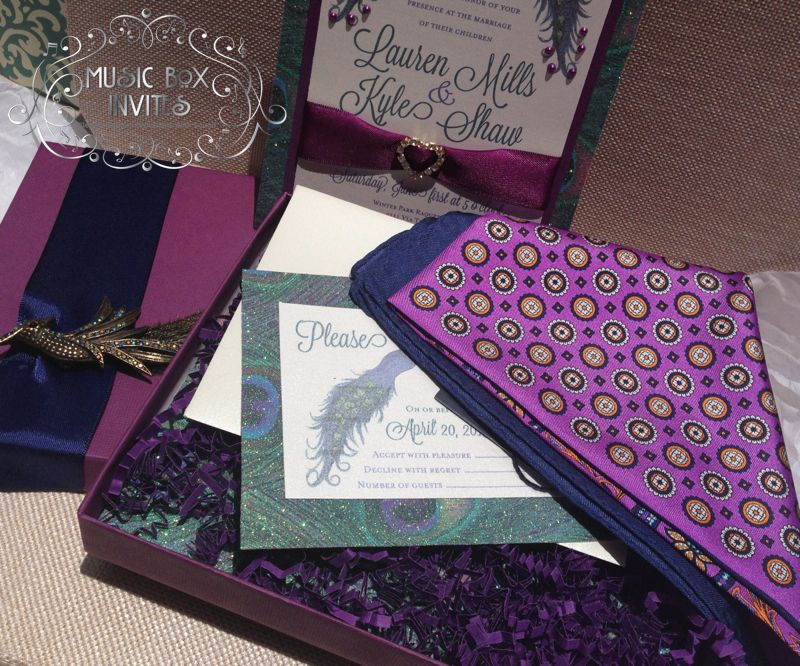Boxed invitations with a special treat - men's pocket square inside! Give your guests a gift, choose what you want and we'll include it. But that's not all, this purple peacock invitation plays music when the box is opened! So cute and thoughtful. Utter luxury.