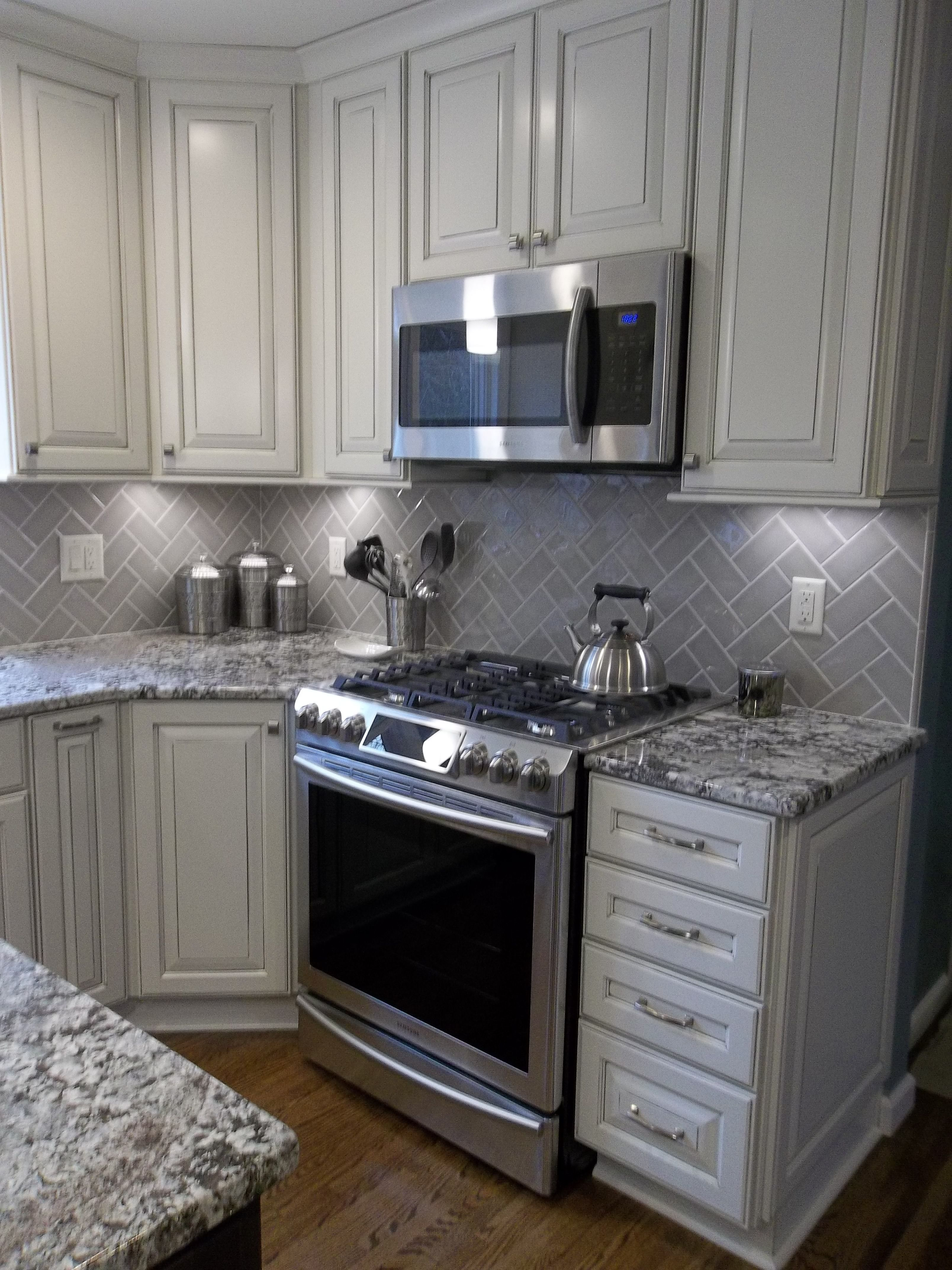 Lowes Caspian Cabinet, grey marble countertop, stone tile ...
