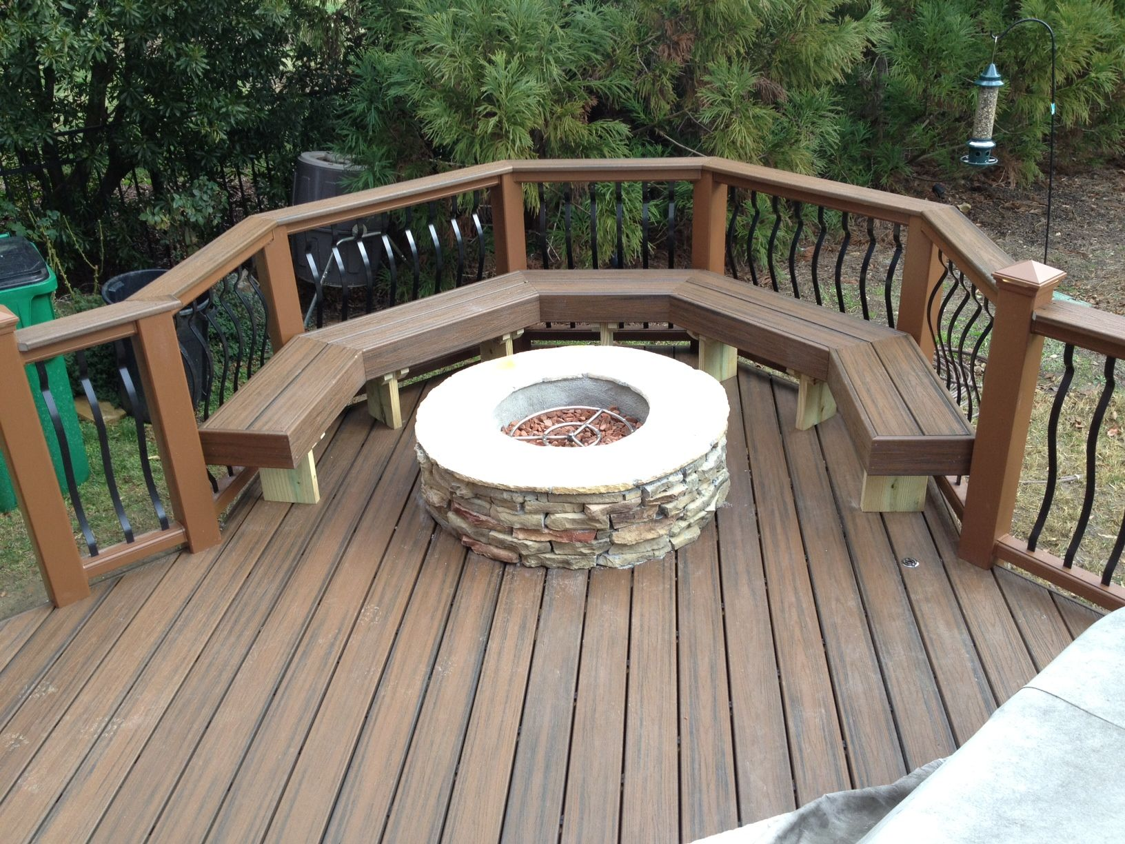 archadeck of charlotte built this trex transcends spice rum composite deck with a composite bench and