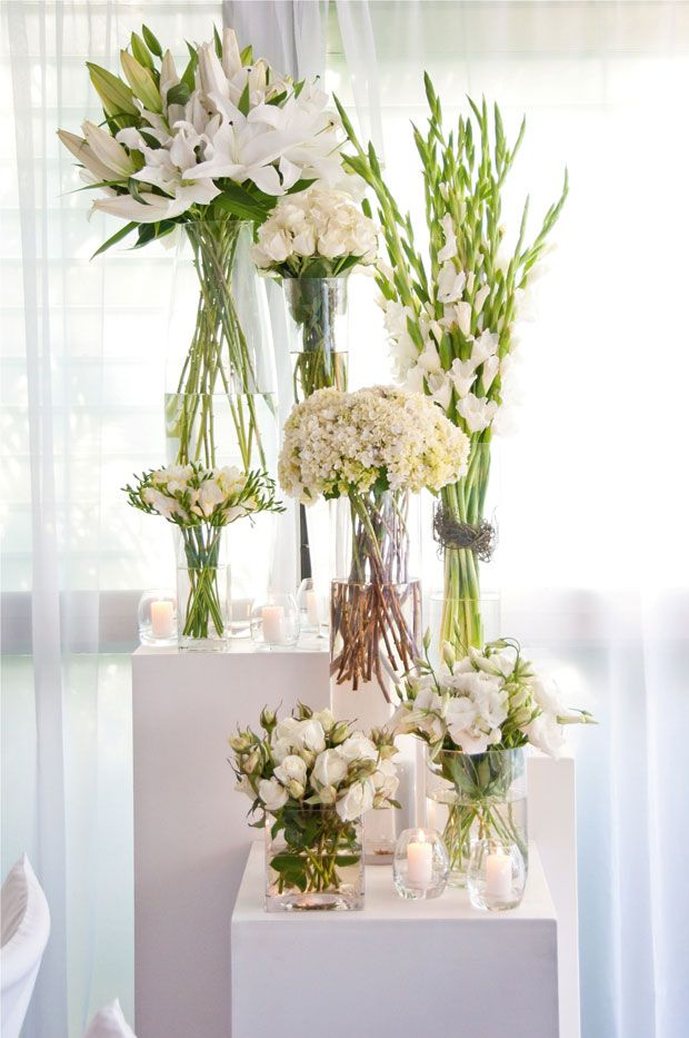 Flowers mondo floral design davel photography wedding of laura white floral feature area on mass including lilies gladioli and freesias mightylinksfo