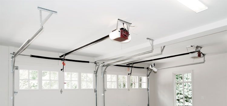 8 Garage Ceiling Ideas For That Finished Look Garage Tool Advisor House Cladding Home Remodeling Garage Door Repair Spring