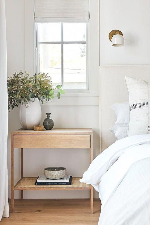 Simple minimalist bedroom design with white and natural