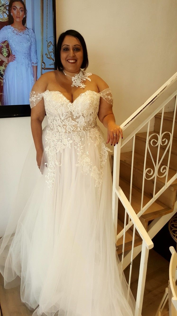 6a20543ef60 Real plus size bride in a corset strapless ball wedding gown with off  shoulder sleeves from Studio Levana