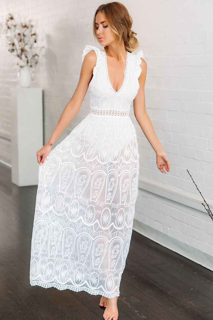 This maxi dress is a total head turner with its sheer design and