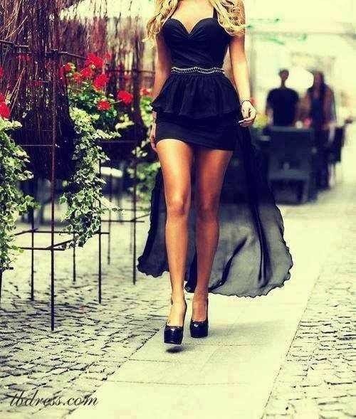 This Is A Black Tail Dress With Gold Belt And High Heels