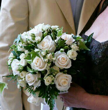 Beautiful Round Wedding Bouquet Showcasing White Roses Spray Green Leather Leaf