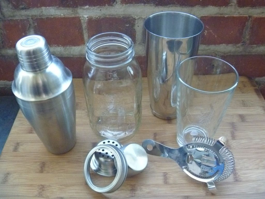 Shakers, l-r: traditional metal cocktail shaker; mason jar cocktail shaker with screw lid, strainer and cap; and the Boston shaker trio - a bar tin, mixing glass and strainer.