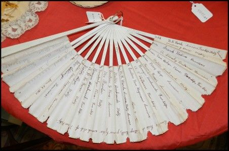 the fan was actually a  dance card for several dances held in town at the turn of the century. The dances listed on this dance fan are the Lanciers (a dance for four couples in a quadrille or square), the Two-Step (a quick partner dance) and the Waltz (a fluid, romantic partner dance), three popular dances of the era which allowed for fun as well as propriety.