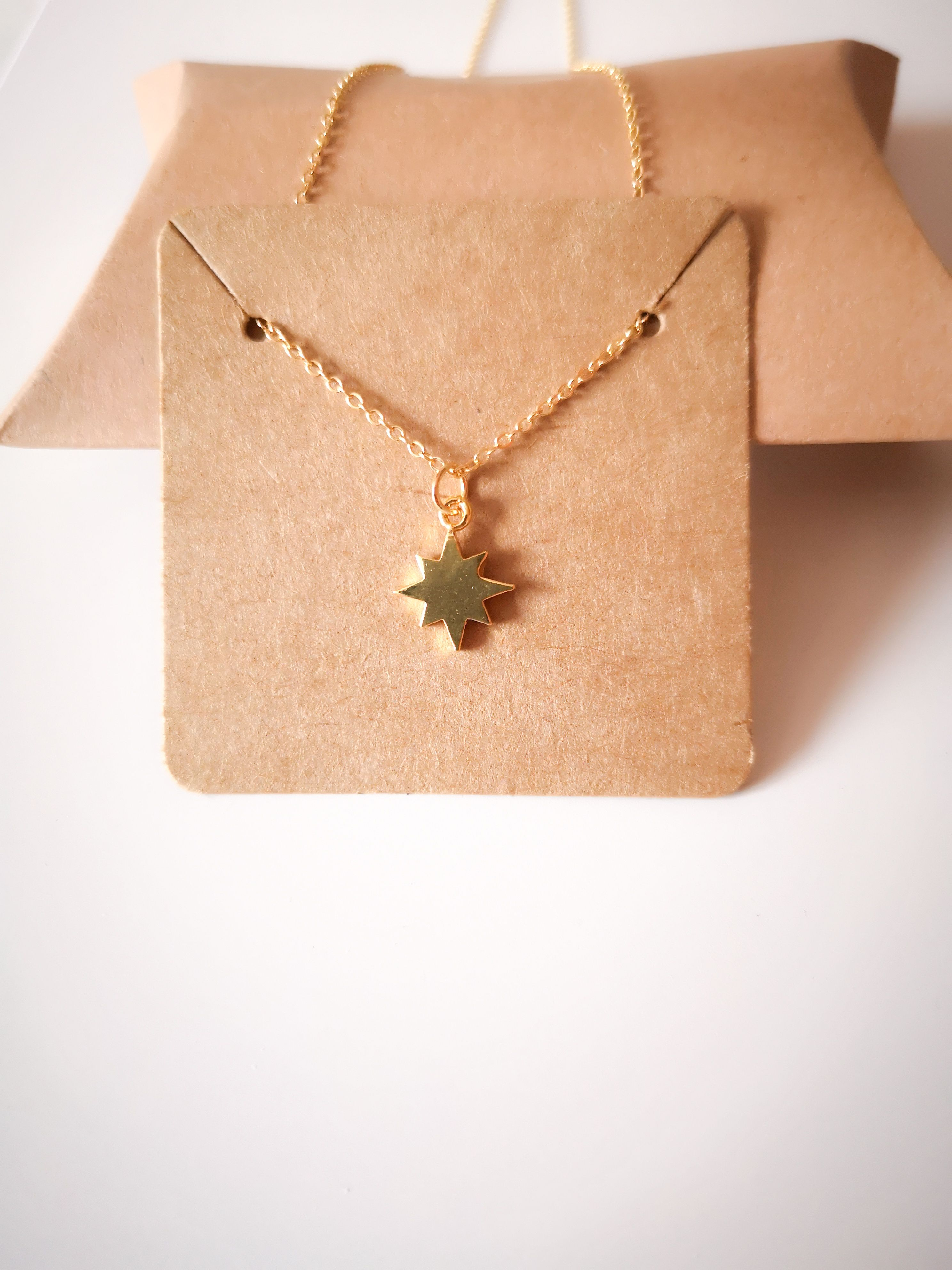 Photo of Gold North Star Necklace