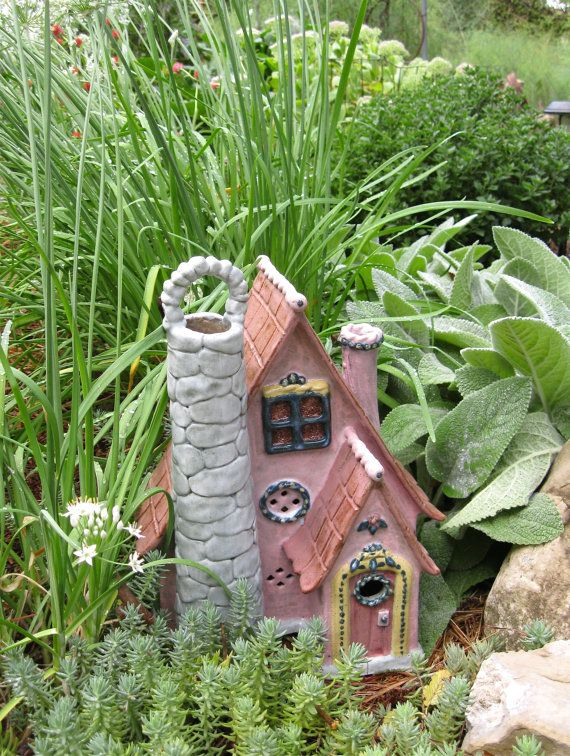 The Storybook Fairy House is just the place for any of your enchanted garden dwellers to live, be they fairies, gnomes or toads. She has a handy
