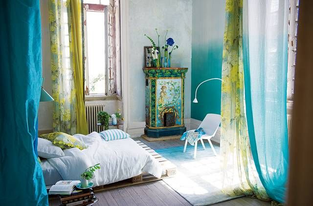 I've been noticing a trend of ombre walls and non-matching pairs of curtains. Love the little heater in the corner.