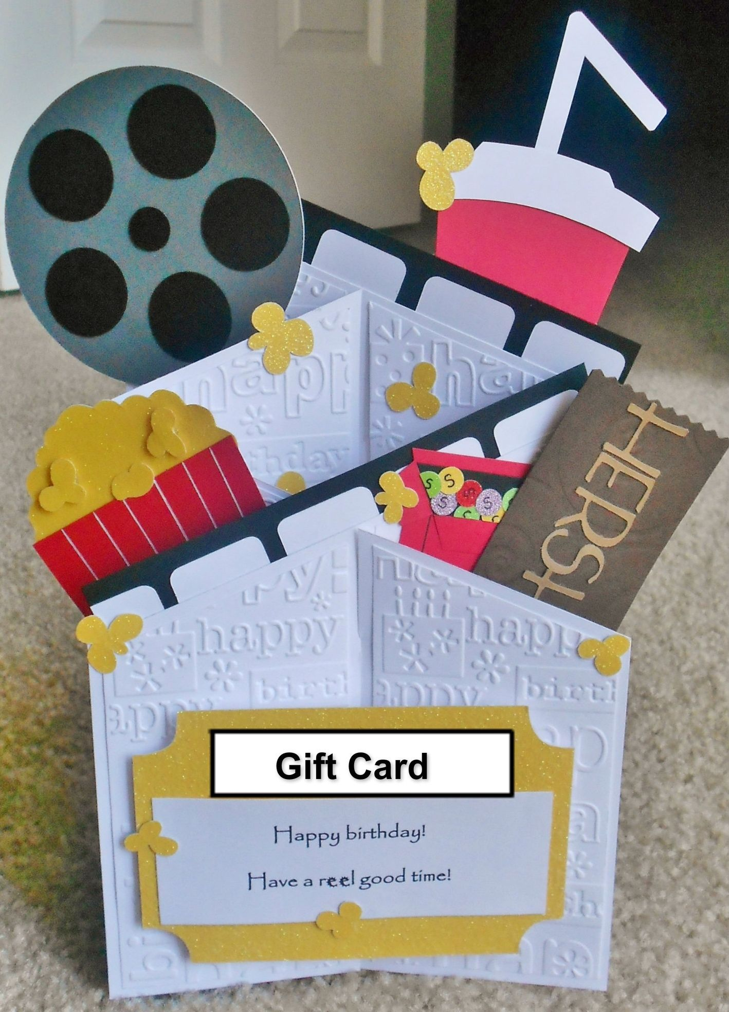 "Cascade card with gift card holder. Saying ""Happy birthday, Have a reel good time!"" **If you would like your card to be signed in your name and mailed directly to the recipient, please provide their address and your name."