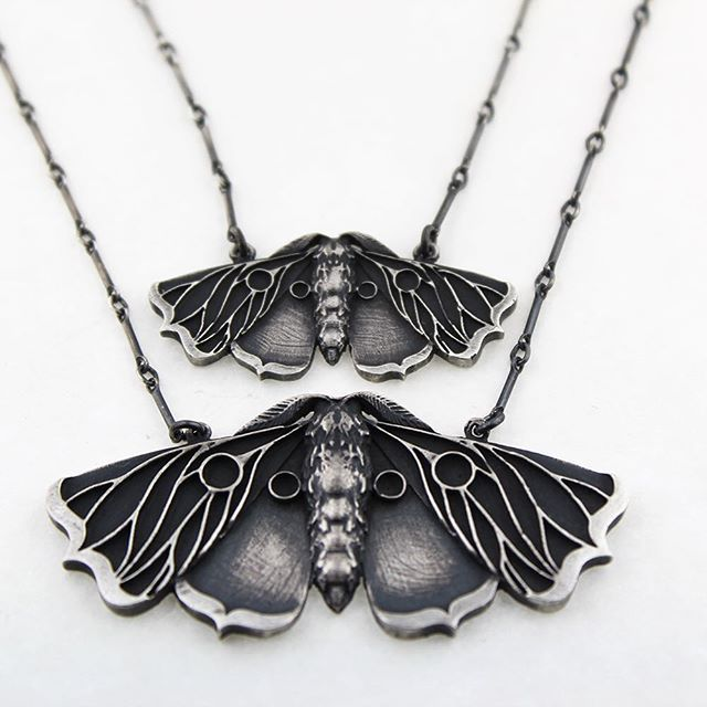 Live in my shop: bloodmilkjewels.com The planchette moth is loosely based on the body of black moths and its wings are in the shape of planchettes, a symbol that has long been the heart of my line and an enduring personal symbol.  I was inspired by several things, chiefly being the writings of Carl Jung on the process of 'Inner Alchemy'. Each phase of the alchemical process from antiquity was re-assigned new meanings: i.e. the quest for the philosopher's stone is truly a quest to become…