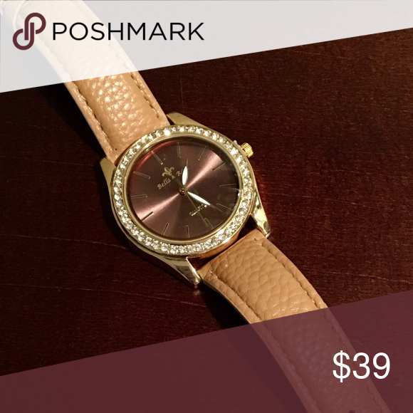Brand new Watch Brand new Bella & Rose watch, tan leather band with a beautiful shiny gold tone and rhinestones around the face of the watch.  Stunning! bella and rose Accessories Watches