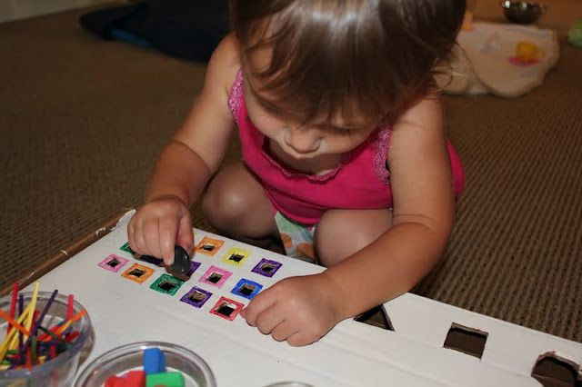 Cardboard box sensory table. Maybe use some bigger objects for little ones.