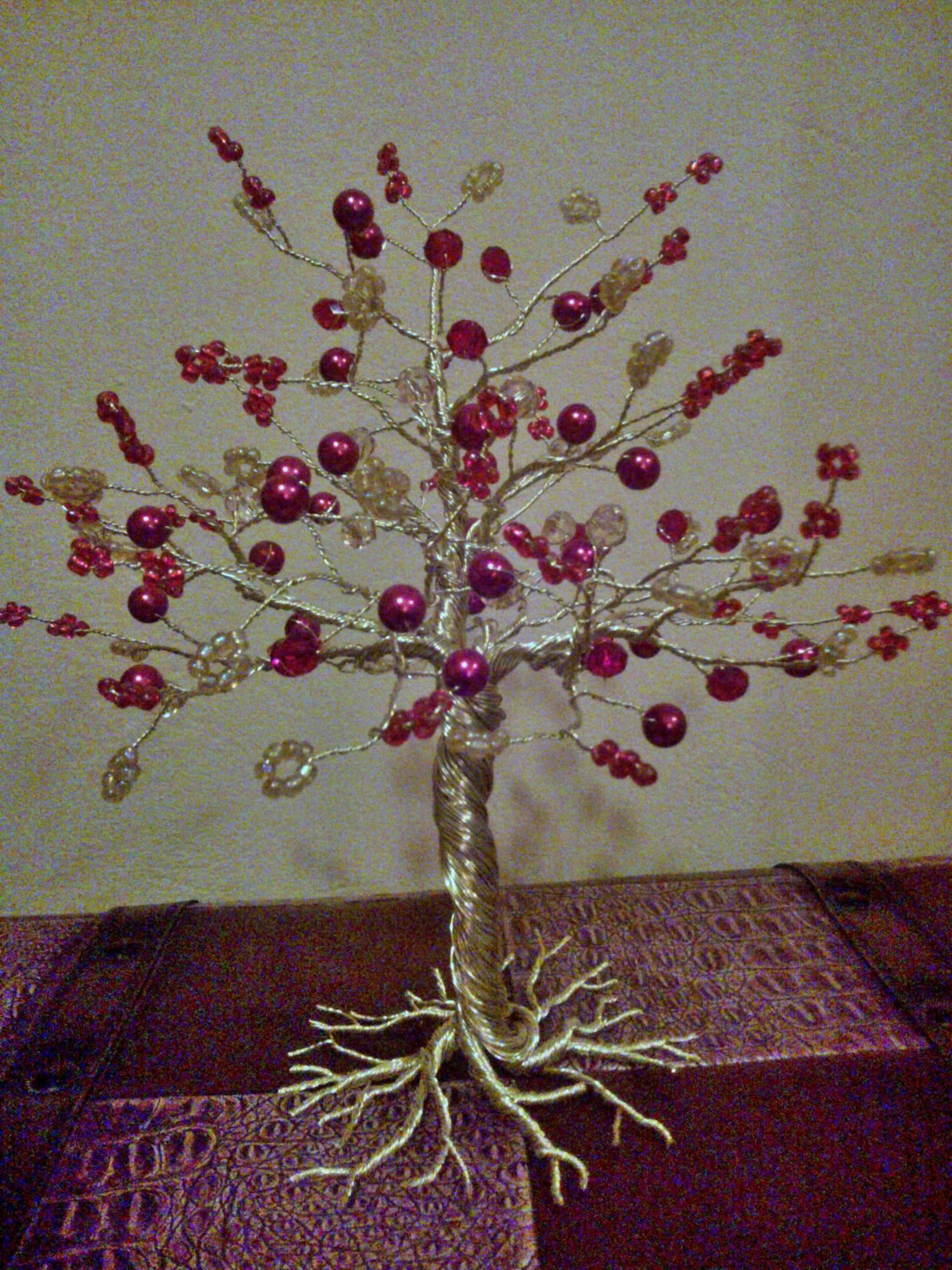 Wire tree with red pearls and beads.